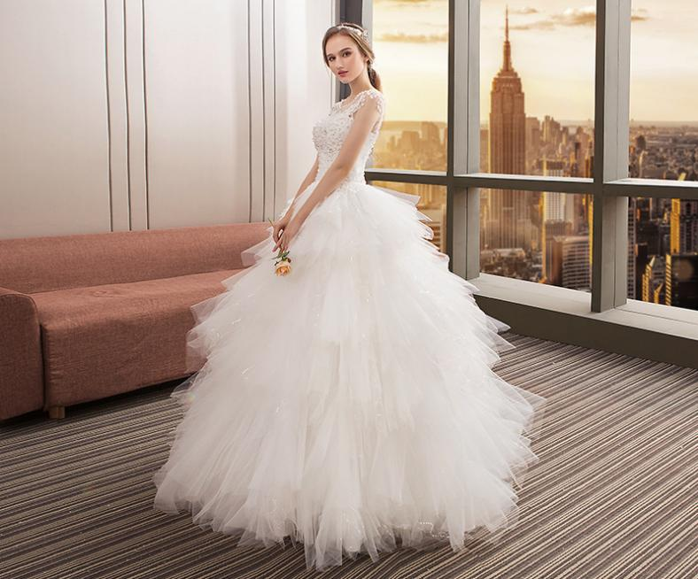 VENSANAC Crystal Pearls O Neck Feathers Ball Gown Wedding Dresses 2018 Lace Appliques Backless Tulle Bridal Gowns in Wedding Dresses from Weddings Events