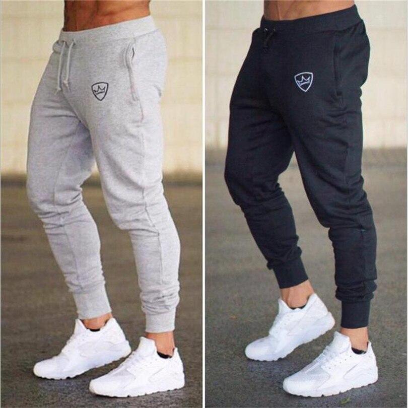 Otoño de 2018 marca gimnasios hombres corredores chándal hombres chándal Pantalones deportivos ropa de la alta calidad pantalones de sueltas