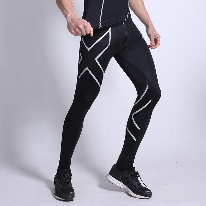купить Men Compression Sport Pants Elastic Tights Fitness Jogging Clothes Skinny Gym Running Legging Trousers Plus Size 3XL Sportswear по цене 775.17 рублей