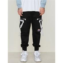 цена UNCLEDONJM Side Eye-splice Tape Hip Hop Sweat Pants Multi Pockets Trousers Sweatpants Streetwear Men Joggers Cargo Pants 053W в интернет-магазинах