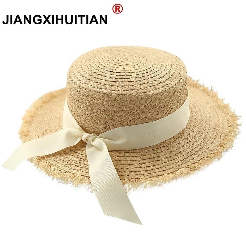Tienda Online Nuevas mujeres simples verano playa rafia negro blanco cinta  arco sombrero de rafia temperamento paja plana sombreros de mar de las  mujeres ... cae718e9a88f