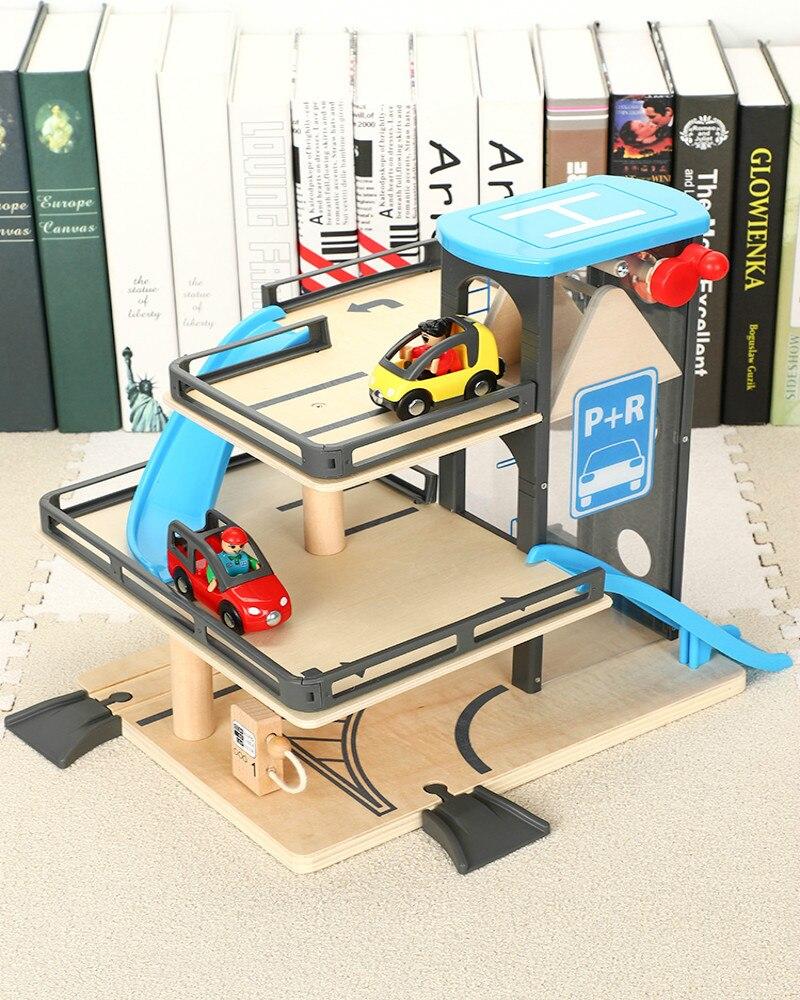 Train de voie en bois éducatif chemin de fer bois Simulation ascenseur Parking voiture de chemin de fer jouet Compatible Millet Brio cadeau de fête des enfants