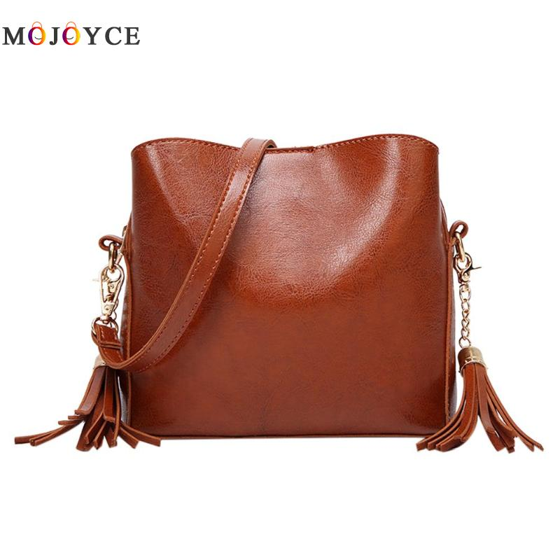 все цены на Vintage Women PU Leather Zipper Shoulder Bag Pure Color Tassels Messenger Crossbody Bucket Bags Ladies Handbags онлайн