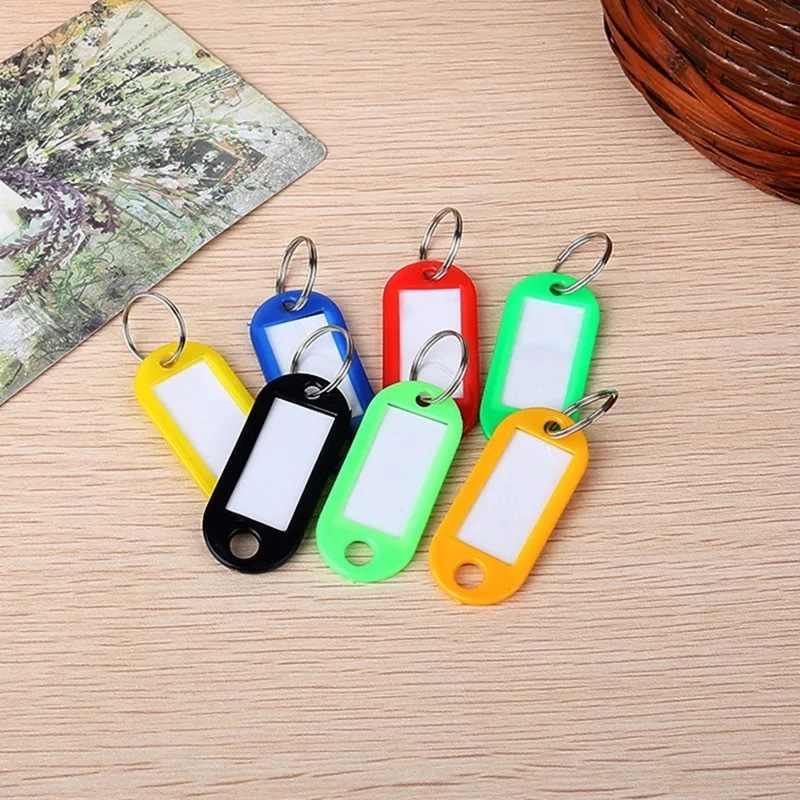 1 piezas de plástico llavero llaveros equipaje etiquetas de identificación etiquetas clave con el nombre tarjetas Multi-función de regalo al azar color