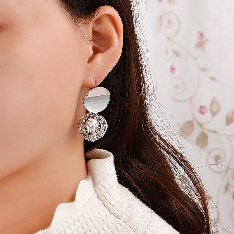 Hot Women 39 s Fashion Statement Earrings Geometric Metal Hollow Ball Drop Earing For Women Jewelry Aretes De Mujer Modernos 2019 in Drop Earrings from Jewelry amp Accessories