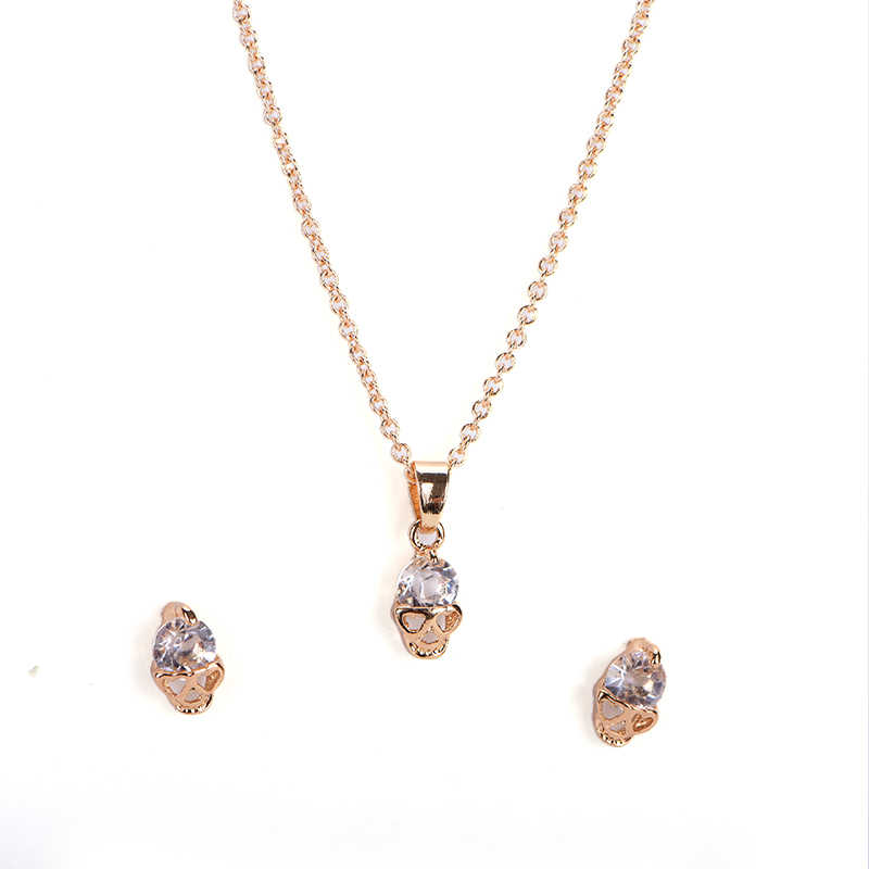 طقم مجوهرات أقراط على شكل جمجمة بحجر الراين مطلي بالذهب أنيق