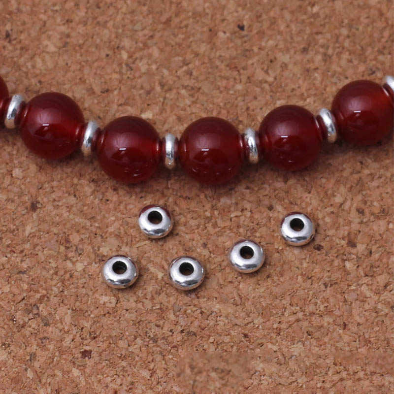 50 pz/lotto Argento Tibetano Rotonda e Piatta Piccolo Perle di Metallo 5 millimetri Decorazione Borda Spacer Accessori di Gioielli FAI DA TE Che Fanno I Braccialetti Regalo