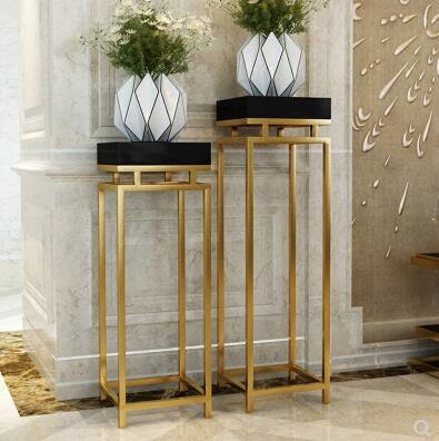 Classic stainless steel gilt rack. Modern living room decorated with plant flower stand.. flower decorated bag accessory