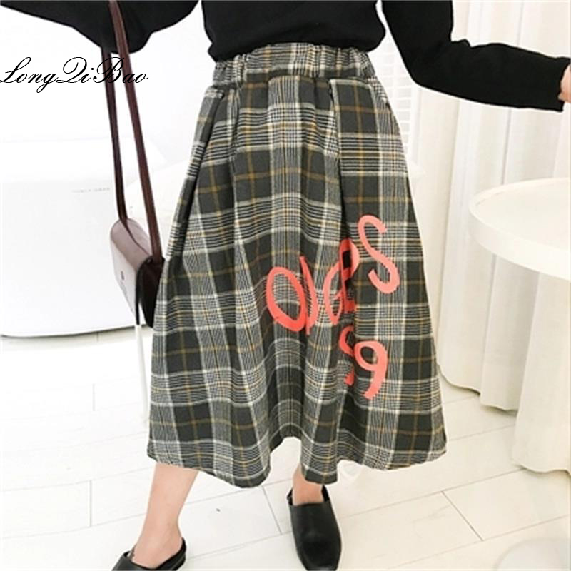 все цены на Baby girl plus velvet skirt 2018 autumn and winter new big children Korean version of the lady wild plaid print long skirt tide