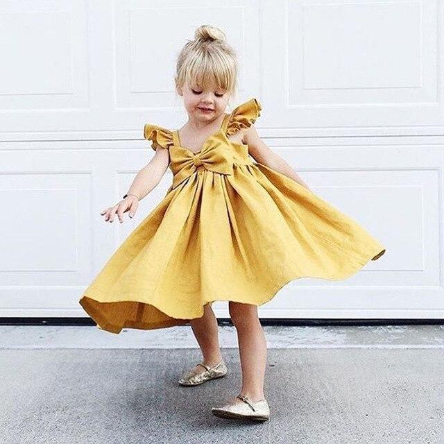 Vestido Da Menina de bebê Verão Meninas Manga Sopro Amarelo Rosa Arco Vestido de Roupas Infantis Menina Meninas Da Criança Vestir Roupas Casuais