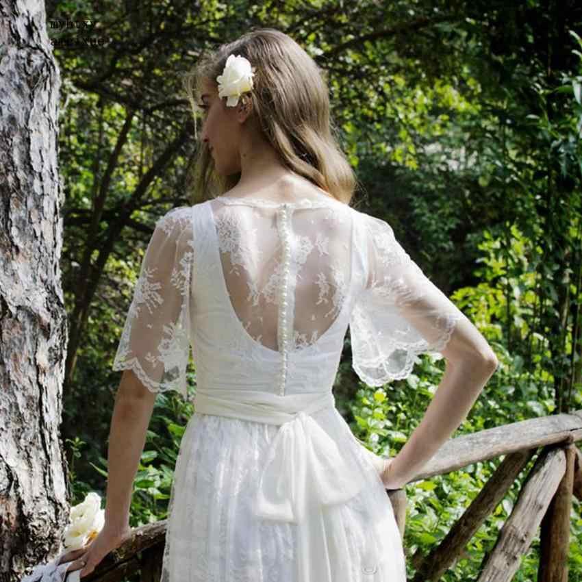 2019 popularny krótki rękaw wycięciem Lace plaża suknie ślubne przepuszczalność z przyciskiem suknia panny młodej Sweep pociąg Vestido De noiva