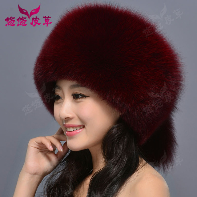 Woman wearing real fur winter fox / raccoon fur hat with a Russian fur tail new fashion high quality women's brand hat ear