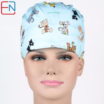 unisex scrub caps in light blue with doggies Hennar brand image
