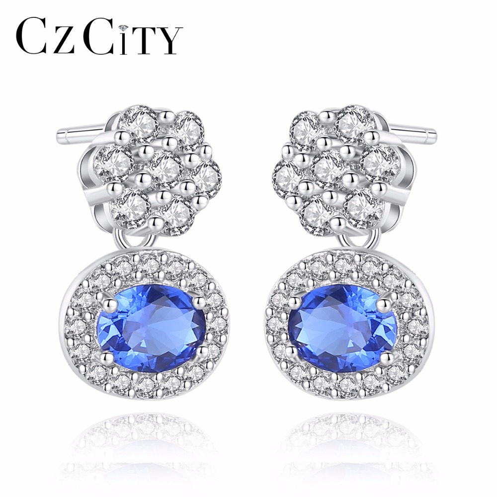 CZCITY New Blue Oval Topaz Stud Earrings With Solid Miniature White Zircon Flowers 925 Sterling Silver Fine Jewelry For Women