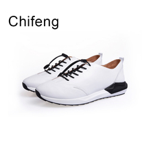 males's informal footwear model breathable strolling loafers mens footwear spring autumn real leather-based black white Men vulcanized footwear