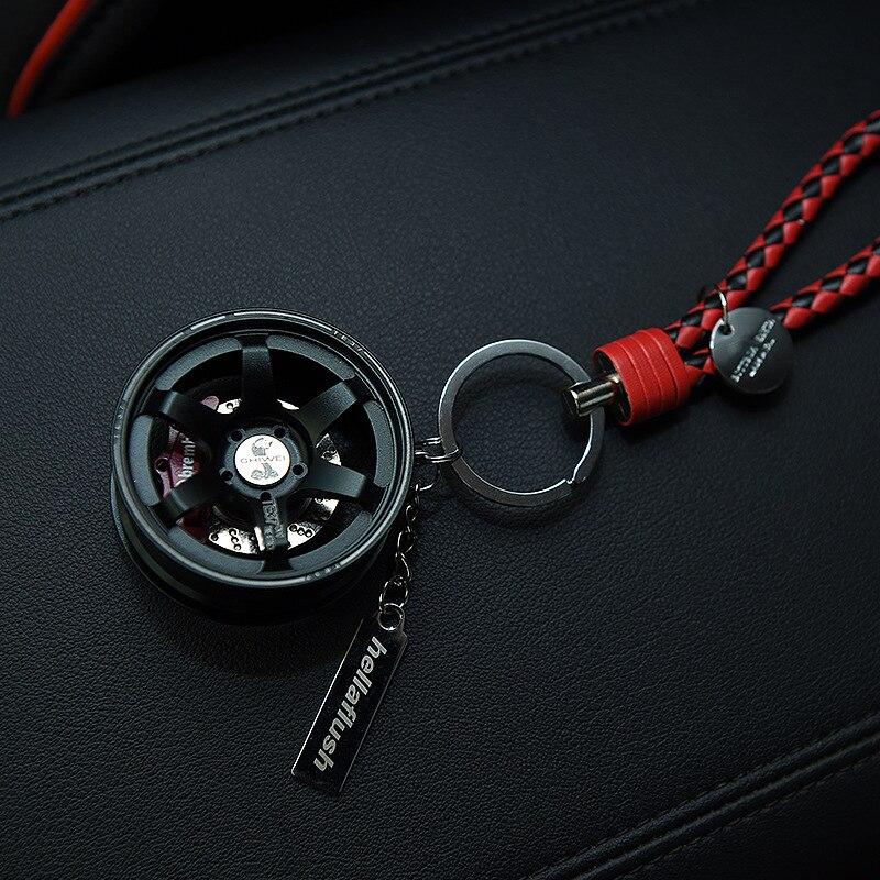 Toyikie luxo metal roda carro chaveiro com corda de couro 360 girar disco freio keyring sleutelhanger llaveros chaveiro