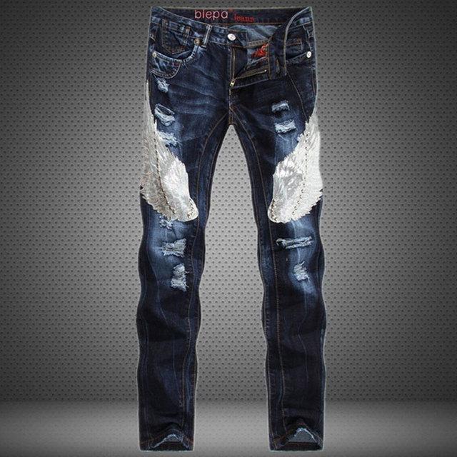 Águila Patchwork Pantalones Vaqueros Del Agujero de Los Hombres de Moda Marca De Jean Biker Jeans Homme Lentejuelas rised Mediados Delgados Rectos Ripped Jeans Casual pantalones