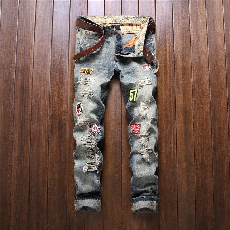 Fashion ripped pants men embroidery with badges light blue distressed jeans for men hip hop moto trousers boys hole denim fabric