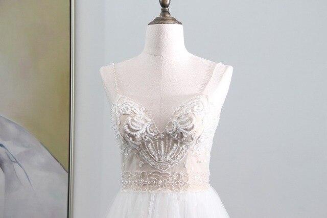 Robes de mariée romantique plage robes de mariée 2018 Sexy dos nu Tulle perles mariée robe de mariée Style dété