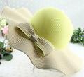 2016 nueva verano sólido arco grande de ala ancha cordón de la onda sombrero de paja del casquillo para mujeres