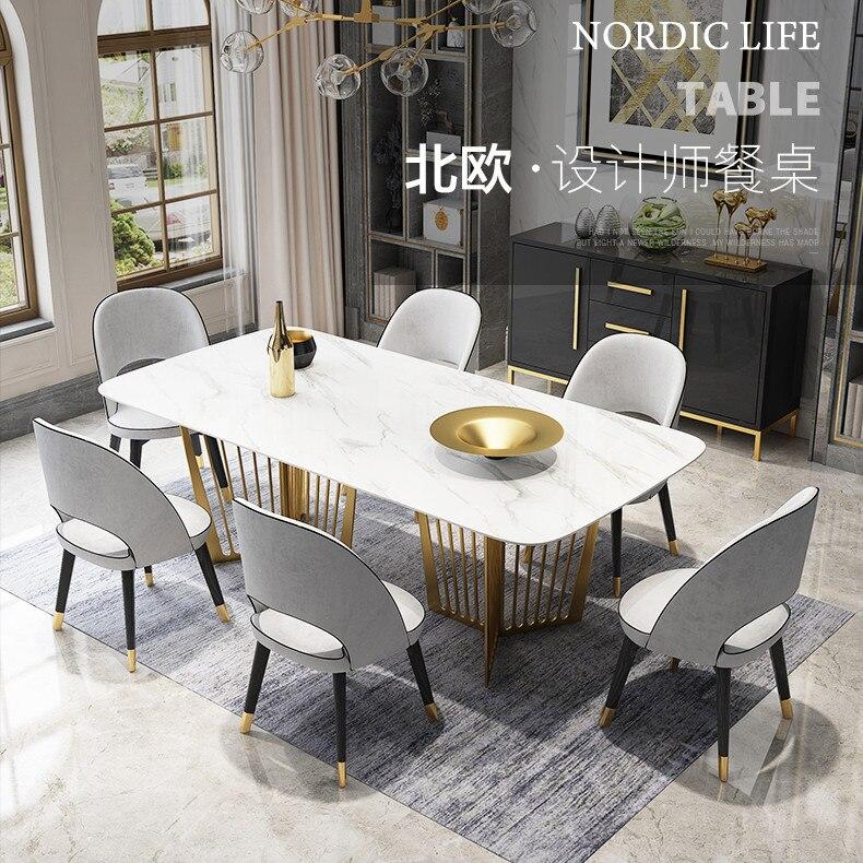 table a manger haute en blanc avec 6 chaises et dessus en marbre blanc