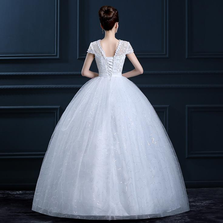 VAMOLASC Illusion Sequined O Neck Ball Gown Lace Wedding Dresses Short Cap Sleeve Bow Sash Backless Bridal Gowns in Wedding Dresses from Weddings Events
