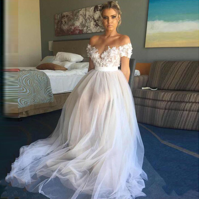Us 98 57 38 Off Lorie Off The Shoulder Boho Wedding Dresses A Line White Ivory A Line Appliques Lace Tulle Short Sleeves Beach Bridal Gown 2019 In