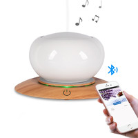Bluetooth Speaker Ceramic Aroma Essential Oil Diffuser Waterless Auto Shut off 7 Color LED Ultrasonic Humidifier