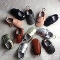 100 pares/lote New Genuine Mocassins De Couro Do Bebê Sapatos sólidos keychain design Sapatas de Bebê Recém-nascido primeira walker Shoes Infantil