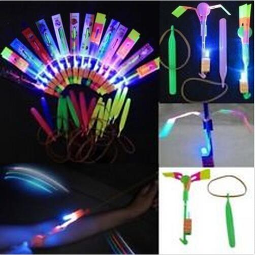 50pcs Amazing LED Light Arrow Rocket Helicopter rotating Flying Toy Party Fun Gift Blue light