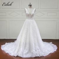 Amazing V Neck Wedding Dress 2018 Backless Pearls Beading Crystal Sparkling Bridal Gown Sashes A Line