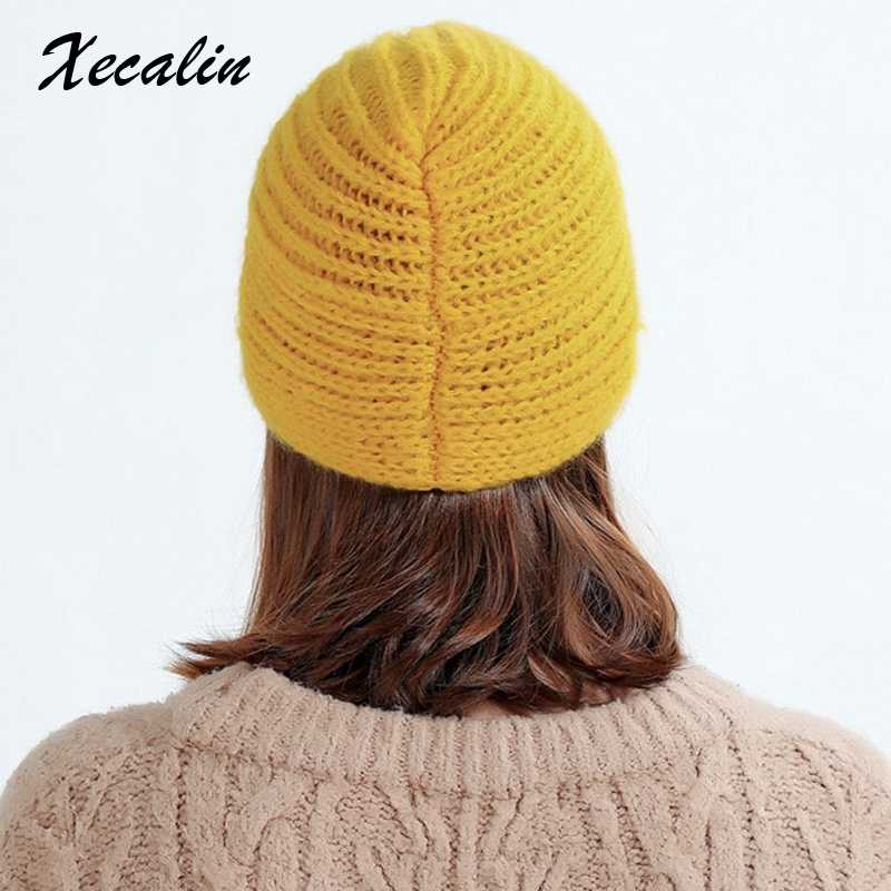 d530539b4 Xecalin 2018 Winter hats Women off White Knitted Beanie Female Warm Yellow  Caps Streetwear Gorros Mujer Invierno