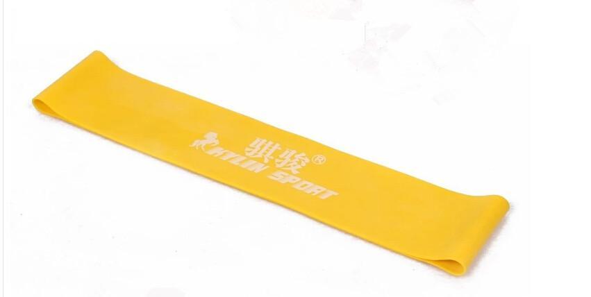 gelbes Spannungs-Widerstand-Band-Übungs-Schleifen-Stärke-Gewicht-Trainings-Eignung Pilates Yogaband geben Verschiffen frei