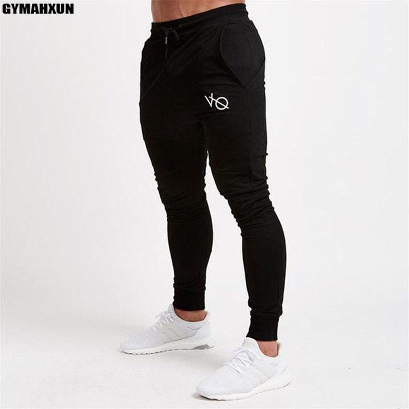 718c25155a GYMAHXUN novo calças Dos Homens Sweatpants Jogger Calças Bolso ACADEMIAS de  Musculação moda de alta qualidade