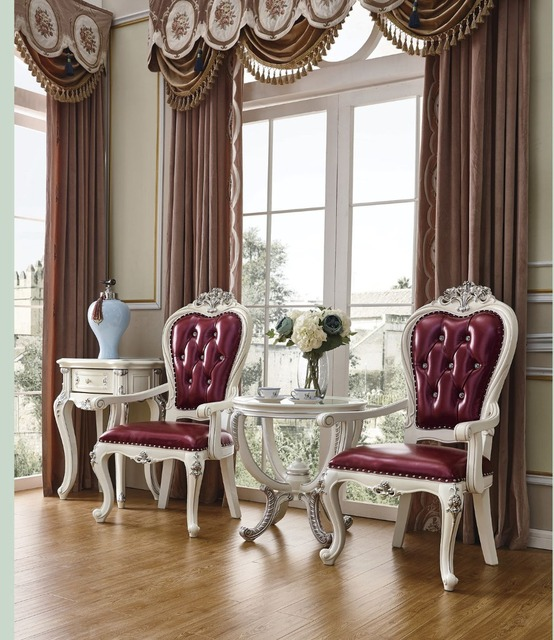Round table with 2 arm chairs