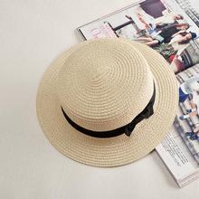 Nuevo Sol de moda plana sombrero de paja navegante sombrero niñas arco  sombreros de verano para las mujeres playa Panamá sombrer. 677b74a0ba8