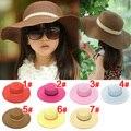 2015 venta al por menor 7 colores niños del verano sólido Simple elegante de ala ancha sombrero de paja del bebé sombreros de la playa del sombrero del sol