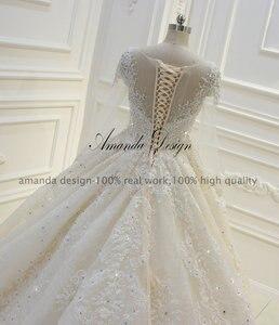 Image 5 - فستان زفاف عالي الجودة بأكمام طويلة مزين باللؤلؤ الشامبانيا بتصميم أماندا