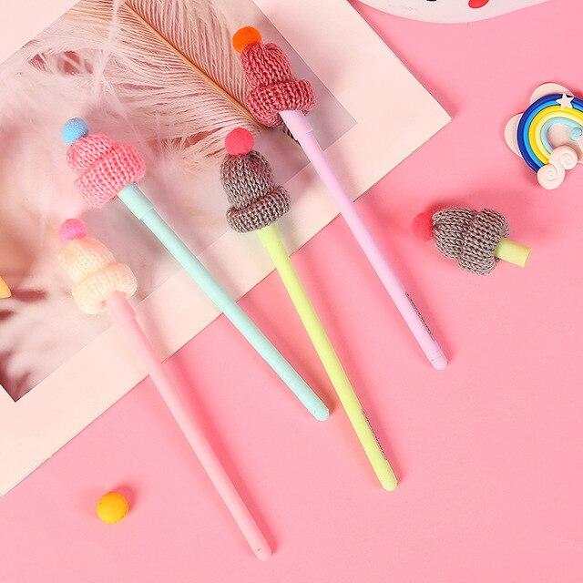 1 piezas pluma Kawaii creativo lindo sombrero de punto Gel pluma 0,5mm negro tinta estudiante herramienta de escritura Escolar Papelaria de la escuela suministros de oficina