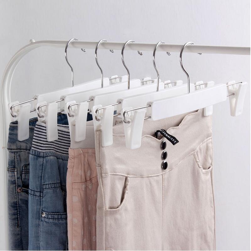 20 Pcs/Lot réglable en plastique blanc pantalon jupe cintre avec Clips, support de cintre inférieur pour magasin de vêtements-in Cintres et rails from Maison & Animalerie    3