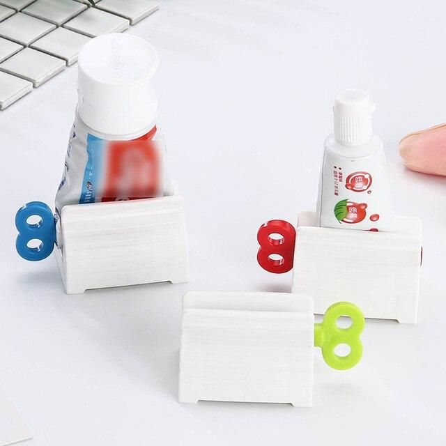 Wielofunkcyjny łazienka z tworzywa sztucznego tubka kremu do wyciskania pasty do zębów dozownik Rolling Tube wyciskacz Paster akcesoria łazienkowe zestaw