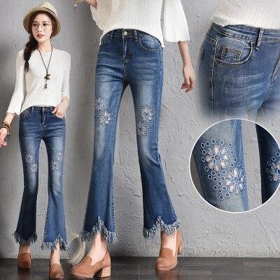 Женские расклешенные брюки с высокой талией и вышивкой