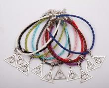 Hot 50pcs Harry Potter Deathly Hallows Charms Pendants Mixed Color Braided Rope Bracelets Fashion Jewelry DIY For Women&Men F729 deathly hallows wax seals s logo harry potter multi color brass stamp