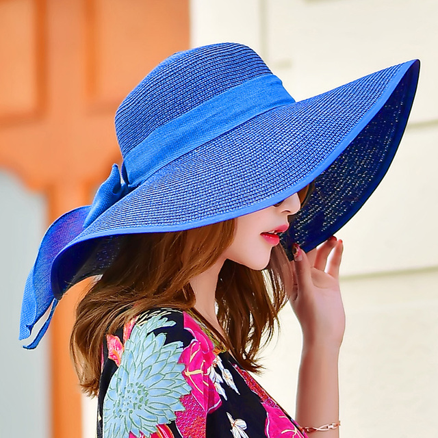 9179878f9 Hawaii Straw Hats for Women Floppy Foldable Women Bowknot Beach Sun Hat  Female Summer Wide Brim Sunhat Flat Cap Chapeau B685
