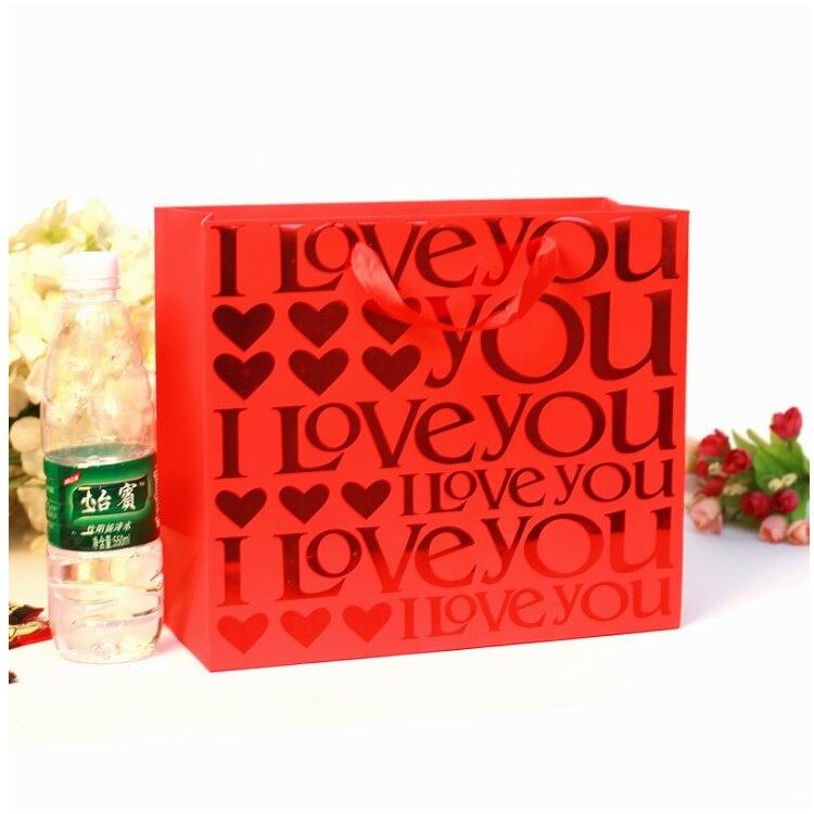 100 pièces chinois traditionnel rouge Double bonheur mariage cadeau papier sac Portable bonbons sacs 25*9.4*19 cm lin4035