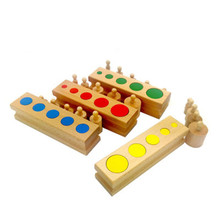 Купить с кэшбэком New Wooden Baby Toy Montessori Cylinder Blocks Toys 4 piece and  Colorful Knotless Cylinders Wooden Baby Gifts