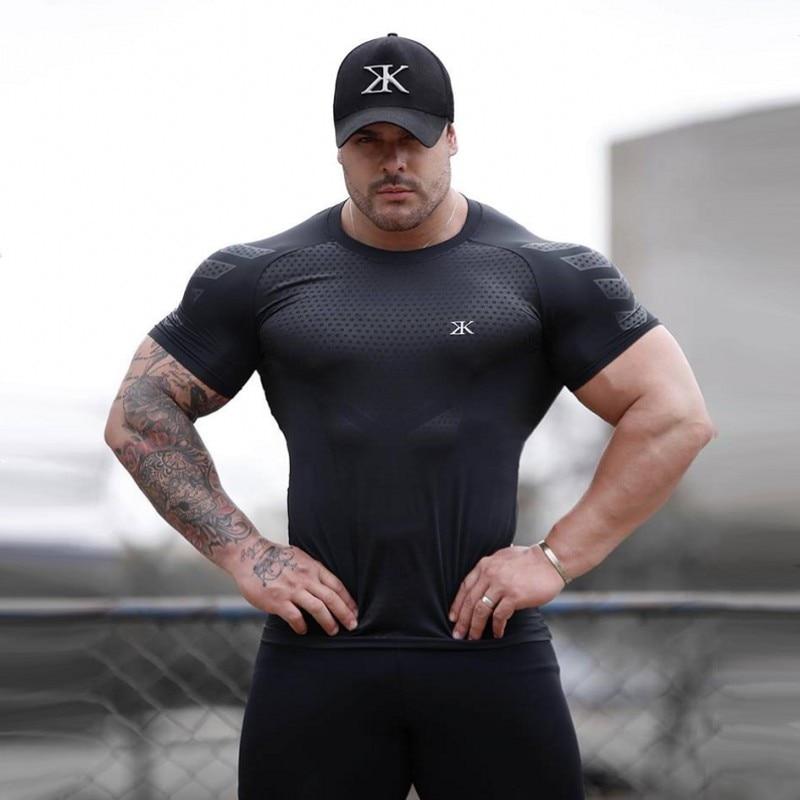 Carga de secado rápido de compresión de los hombres camisetas de manga corta Camisa Fitness apretado directo de fútbol Jersey gimnasio Demix ropa deportiva