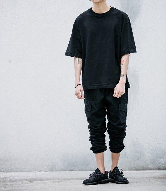 Dentro de la costura rayado harem hombres pantalones cargo dibujar cadena hip hop pantalones 30.32.34.36 negro de algodón