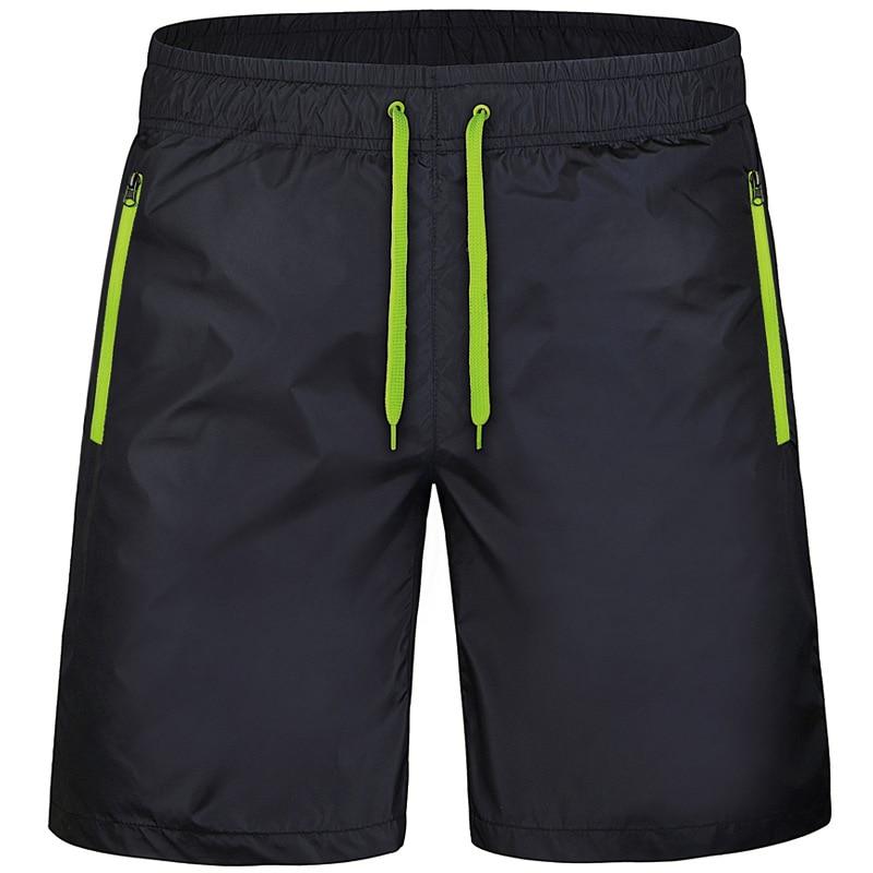בתוספת גודל Mens מכנסיים קיץ ריצה ספורט קצר גברים פסים מהיר ייבוש לנשימה כושר כושר ספורטוויר גברים חוף מכנסיים קצרים