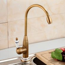 цена на Kitchen Faucet Antique Brass Swivel Bathroom Basin Sink Mixer Tap With Ceramic Crane Hot & Cold Kitchen Sink Faucet Water Mixer